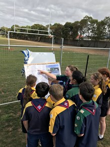 Scouts checking out the plans for their new hall